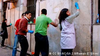 Egyptians cleaning the street after the protests