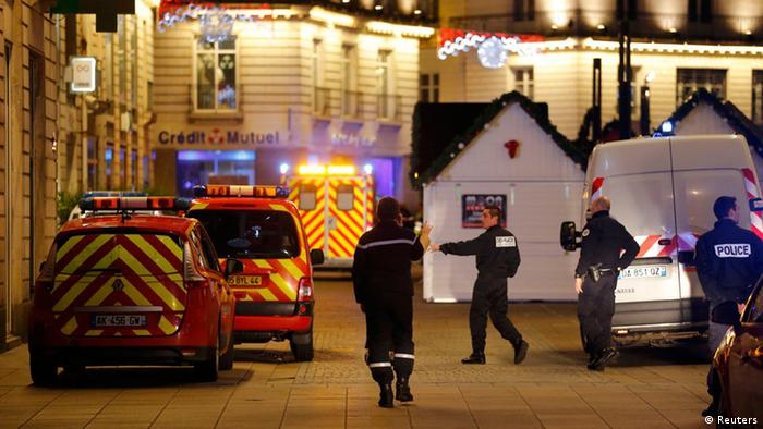 Police and rescue crews are seen near a Christmas market in Nantes
