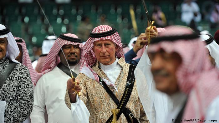 Prince Charles (C) wearing traditional Saudi uniform, dances with sword (Nureldine/AFP/Getty Images)
