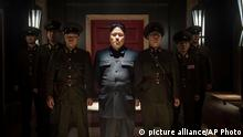 In this undated photo provided by Columbia Pictures - Sony, Actor Randall Park, center, portrays North Korean leader Kim Jong Un in Columbia Pictures' The Interview. If the U.S. government¿s claim that North Korea was involved in the unprecedented hack attack on Sony Pictures that scuttled Seth Rogen¿s latest comedy is correct, no one can say they weren¿t warned. The movie, ¿The Interview,¿ pushed all of North Korea¿s buttons. (AP Photo/Columbia Pictures - Sony, Ed Araquel)