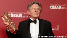 Director Roman Polanski poses with his Best Director award for La Venus A La Fourrure (Venus in Fur) during a photocall at the 39th Cesar Awards ceremony in Paris in this file photo taken February 28, 2014. Lawyers for filmmaker Roman Polanski are seeking to have a case involving a 1977 charge of unlawful sex with a 13-year-old girl dismissed, U.S. newspapers reported on December 16, 2014. REUTERS/Regis Duvignau/Files (FRANCE - Tags: ENTERTAINMENT)
