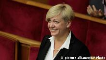 Valeria Gontareva new National Bank Chief speaks to lawmakers during a session of the parliament in Kiev, Ukraine, Thursday, June 19, 2014. The Ukrainian parliament on Thursday approved Ukraine's new foreign minister, prosecutor-general and National Bank Chief. (AP Photo/Sergei Chuzavkov)