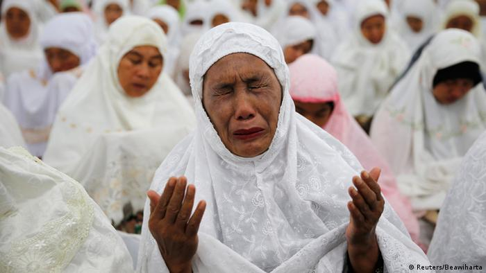 Mourners pictured in Indonesia