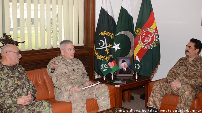 Pakistan Army Chief General Raheel Sharif (R), Afghan Army Chief General Mohammad Karimi (L) and ISAF Commander-General John Campbell (C) meet at the Pakistan Army Command on December 23,2014 after a gun-and-bomb terrorist attack on the army-run school in northwestern Pakistan's Peshawar city killed over 140 people, mostly students, on December 16