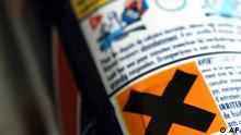 A common household product carries the hazardous label, marked X, in Brussels, Tuesday Dec. 13, 2005. European Union ministers on Tuesday approved a landmark law to control the use of chemicals, after two years of discussion and intense lobbying. The law will require firms to register all chemicals that they use, and to get authorization to use toxic substances. (AP Photo/Geert Vanden Wijngaert)