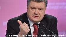 Ukrainian President Petro Poroshenko speaks during a news conference in Kiev, in this December 29, 2014 handout photo provided by the Ukrainian Presidential Press Service. Poroshenko said on Monday he would meet with French President Francois Hollande, German Chancellor Angela Merkel and Russia's Vladimir Putin on Jan. 15. REUTERS/Ukrainian Presidential Press Service/Mykola Lazarenko/Handout via Reuters (UKRAINE - Tags: POLITICS) ATTENTION EDITORS - THIS PICTURE WAS PROVIDED BY A THIRD PARTY. REUTERS IS UNABLE TO INDEPENDENTLY VERIFY THE AUTHENTICITY, CONTENT, LOCATION OR DATE OF THIS IMAGE. THIS PICTURE IS DISTRIBUTED EXACTLY AS RECEIVED BY REUTERS, AS A SERVICE TO CLIENTS. FOR EDITORIAL USE ONLY. NOT FOR SALE FOR MARKETING OR ADVERTISING CAMPAIGNS. THIS IMAGE HAS BEEN SUPPLIED BY A THIRD PARTY. IT IS DISTRIBUTED, EXACTLY AS RECEIVED BY REUTERS, AS A SERVICE TO CLIENTS