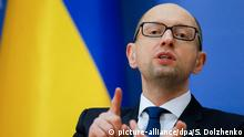 epa04542906 Ukrainian Prime Minister Arseniy Yatsenyuk gestures as he speaks to the media during a news conference in Kiev, Ukraine, 30 December 2014. Ukrainian parliament adopted the law on the state budget for 2015 which was submitted by the Cabinet of the Ministers in the early hours of 29 December 2014. EPA/SERGEY DOLZHENKO