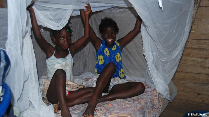 Children sleep under Malaria nets