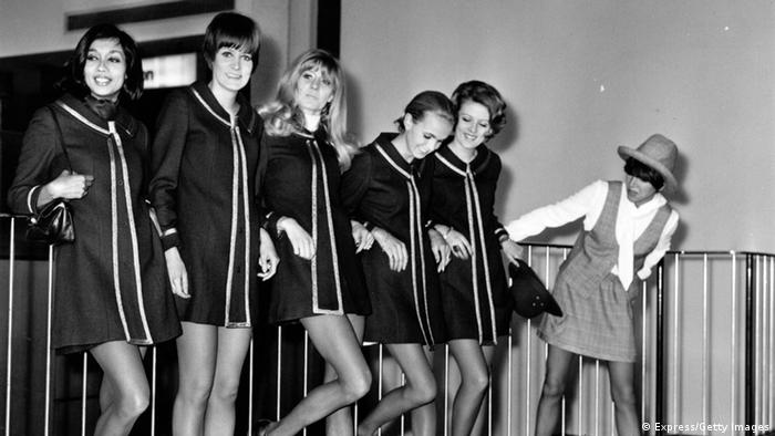 Mary Quant at Heathrow airport with five models