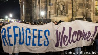 Banner reading 'Refugees Welcome!'