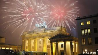 Fireworks explode next to the Quadriga sculpture atop the Brandenburg gate during New Year celebrations in Berlin January 1, 2015.