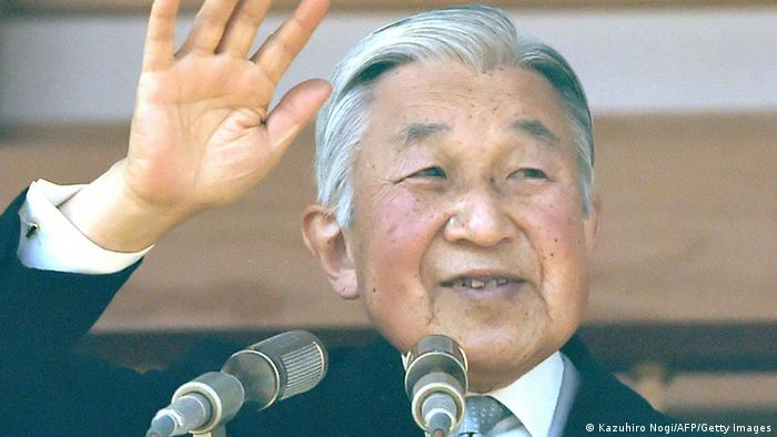Japanese Emperor Akihito waves to crowd.