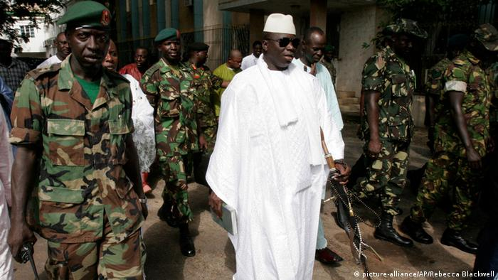 Gambian President Yahya Jammeh, center, leaves a central Banjul polling station