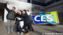 South Korean university students take a selfie in front of an International CES sign at the Las Vegas Convention Center in Las Vegas, Nevada January 4, 2015. The 2015 International Consumer Electronics Show (CES) officially starts on January 6. An estimated 150,000 people and 3,500 exhibitors are expected to attend, according to organizers. REUTERS/Steve Marcus (UNITED STATES - Tags: SCIENCE TECHNOLOGY BUSINESS EDUCATION)