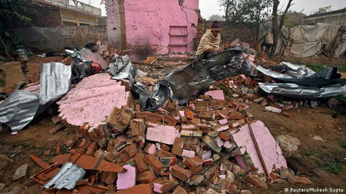 A man's home is destroyed on the Indian side of Kashmir