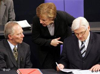 Chancellor Merkel with ministers Schäuble, left, and Steinmeier