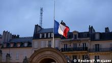 The French flag flies at half mast above the entrance to the courtyard at the Elysee Palace in a sign of mourning in Paris January 8, 2015. France began a day of mourning for the journalists and police officers shot dead on Wednesday morning by black-hooded gunmen using Kalashnikov assault rifles. REUTERS/Philippe Wojazer (FRANCE - Tags: POLITICS CRIME LAW)