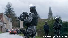 A member of the French GIPN intervention police forces secure a neighbourhood in Corcy, northeast of Paris January 8, 2015. French anti-terrorism police converged on an area northeast of Paris on Thursday after two brothers suspected of being behind an attack on the satirical newspaper Charlie Hebdo were spotted at a petrol station in Villers-Cotterets in the region. France's prime minister said on Thursday he feared the Islamist militants who killed 12 people could strike again as a manhunt for two men widened across the country. REUTERS/Christian Hartmann (FRANCE - Tags: CRIME LAW MILITARY)