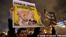 PARIS, FRANCE - JANUARY 08: People hold a vigil at the Place de la Republique (Republic Square) for victims of the terrorist attack, on January 8, 2015 in Paris, France. Twelve people were killed yesterday including two police officers as two gunmen opened fire at the offices of the French satirical publication Charlie Hebdo. (Photo by Dan Kitwood/Getty Images)