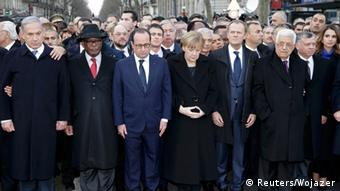 Procession with Francois Hollande in the middle, including Angela Merkel, Benjamin Netanyahu and Mahmud Abbas