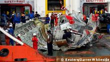 A section of the tail of AirAsia QZ8501 passenger plane is seen on the deck of the ship Crest Onyx, the day after it was lifted from the seabed, as it arrives at Kumai Port, near Pangkalan Bun, central Kalimantan January 11, 2015. Indonesian search teams believe they have found the fuselage of the AirAsia airliner that crashed in the Java Sea two weeks ago, and divers hope calmer waters on Monday will allow them to retrieve the black box flight recorders. Indonesia AirAsia Flight QZ8501 lost contact with air traffic control in bad weather on December 28, less than halfway into a two-hour flight from the Indonesian city of Surabaya to Singapore. None of the 162 people on the aircraft survived. REUTERS/Darren Whiteside (INDONESIA - Tags: DISASTER TRANSPORT MILITARY MARITIME TPX IMAGES OF THE DAY)