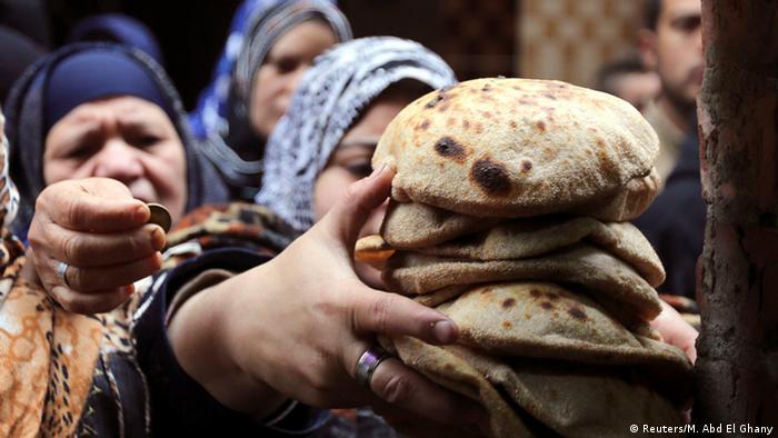 woman buys bread