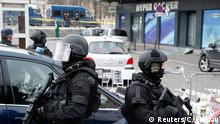 Members of the special French RAID forces secure the area for the visit by Israel's Prime Minister Benjamin Netanyahu to the Hyper Cacher kosher supermarket January 12, 2015 near the Porte de Vincennes in Paris, where four hostages were killed in a terror attack on Friday. Jewish schools and synagogues in France have been promised extra protection, by the army if necessary, after killings by Islamic militants in Paris, the head of the community's umbrella group said on Sunday after a meeting with the French President. REUTERS/Charles Platiau (FRANCE - Tags: CRIME LAW POLITICS CIVIL UNREST SOCIETY)