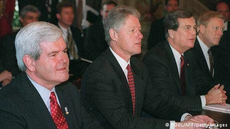US President Bill Clinton seated between Newt Gingrich and Trent Lott Washington (POOL/AFP/Getty Images)