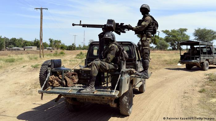 Cameroon soldiers on the back of a truck with machine gun (Reinnier Kaze/AFP/Getty Images)
