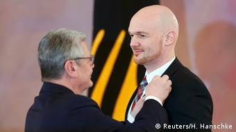 German President Gauck awards astronaut Gerst the Federal Cross of Merit