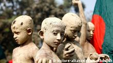 dpatopbilder epa04531161 Bangladeshi children, covered in mud to look like freedom fighters, attend a rally during the Victory Day celebration in Gazipur, Bangladesh, 16 December 2014. Bangladesh marks 43rd Victory Day across the country remembering the war heroes. Bangladesh became a free nation after a nine-month bloody war against Pakistan on 16 December 1971. EPA/ABIR ABDULLAH