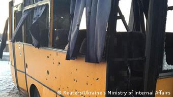 Yellow bus with shell holes. (Photo: REUTERS/Ukraine's Ministry of Internal Affairs/Handout)