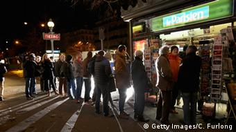 A line of people wait to buy an issue of Charlie Hebdo in January