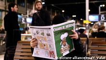 dpatopbilder epa04559182 A man reads the new edition of the French satirical magazine Charlie Hebdo at Gare de Lyon train station, in Paris, France, 14 January 2015. Charlie Hebdo, attacked by gunmen on 07 January, features cartoons of the prophet Muhammad in its edition, and it is published on 14 January. It will have a print run of three million, media reports said, up from an earlier announced run of one million; and far in excess of the weekly magazine's usual circulation of 60,000. EPA/YOAN VALAT