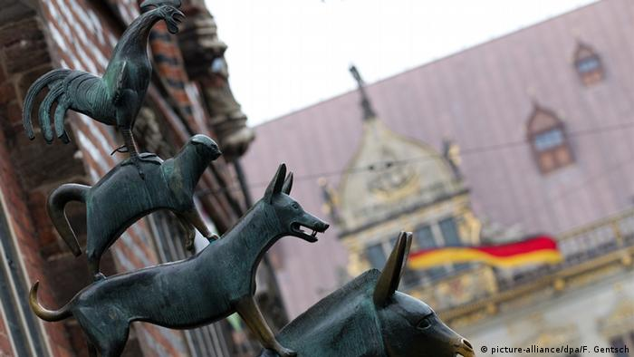 The 1953 bronze statue on the market place depicts story's characters: a donkey, a dog, a cat and a rooster.