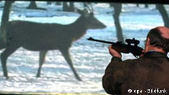 A hunter practices with a shooting simulation