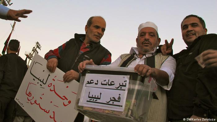 Three Libya Dawn volunteers collect money and goods in Tripoli's martyrs' square