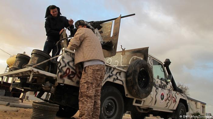 Two militiamen hold a position in Wotya, in Libya´s northwest