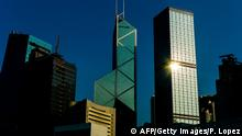 The Bank of China tower (C) and Cheung Kong center (R) is seen in Hong Kong on July 30, 2012. AFP PHOTO / Philippe Lopez (Photo credit should read PHILIPPE LOPEZ/AFP/GettyImages)