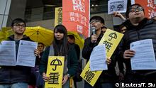 Hong Kong student leaders (L-R) Oscar Lai, Agnes Chow, Joshua Wong and Derek Lam speak as they arrive at the police headquarters in Hong Kong January 16, 2015. Hong Kong student leaders, including Wong, reported to a police station to face arrest for their leadership roles in the months-long pro-democracy protests also known as the Umbrella Movement. REUTERS/Tyrone Siu (CHINA - Tags: POLITICS EDUCATION CIVIL UNREST CRIME LAW)