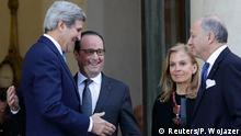 French President Francois Hollande (2ndL) talks with U.S. Secretary of State John Kerry after their meeting attended by US Ambassador to France Jane Hartley (3rdL) and French Foreign Affairs minister Laurent Fabius (R) at the Elysee Palace in Paris January 16, 2015. Ceremonies continue to honour the memories of the 17 people who were killed in last week's attacks. Police arrested a dozen people overnight suspected of helping the Islamist militant gunmen in last week's killings in Paris, the city prosecutor's office said on Friday as U.S. Secretary of State John Kerry arrived for talks. REUTERS/Pilippe Wojazer (FRANCE - Tags: POLITICS CRIME LAW)