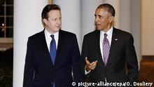 epa04561953 US President Barack Obama (R) and British Prime Minister David Cameron walk the West Wing colonnade of the White House, in Washington DC, USA, 15 January 2015. British Prime Minister David Cameron and US President Barack Obama on 15 January said stronger economies were critical to maintaining free speech and defeating a 'distorted ideology' manifest in Islamist gunmen killing 17 people in Paris last week. Cameron's two-day visit is likely to be his final Washington appearance before May's general election. EPA/Olivier Douliery / POOL