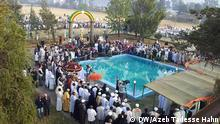 Ethiopian Orthodox church faithful gets out of the cold water of the Addis Abeba , Timket is a religious festival_on January 19, 2015, after plunging to celebrate Orthodox Epiphany. Timket is a religious festival celebrated with much zeal in Addis Ababa, Gondar, and Lalibela in Ethiopia. It is also spelled as Timkat or Timqat. The festival is the Ethiopian Orthodox celebration of Epiphany and venerates Christ's baptism in the River Jordan. Although the festival is observed by orthodox Christians all over the world, in Ethiopia it takes on a special significance as it is the most colourful event of the year in the country. The most relevant symbol of the festival is colourful embroidered umbrellas that protect the sacred Tabot and the priests carrying the Tabot Autor:- Azeb Tadesse Hahn _DW