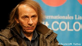 French author Michel Houellebecq speaking in Cologne. Copyright: Reuters/Wolfgang Rattay.