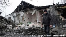 A man walks near a residential building, which according to locals was recently damaged by shelling, in Donetsk, eastern Ukraine January 19, 2015. REUTERS/Alexander Ermochenko (UKRAINE - Tags: CIVIL UNREST CONFLICT POLITICS)