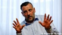 File photo of Lutz Bachmann, co-leader of anti-immigration group PEGIDA, a German abbreviation for Patriotic Europeans against the Islamization of the West, pictured during a Reuters interview in Dresden January 12, 2015. The leader of the fast-growing German anti-Muslim movement PEGIDA resigned January 2, 2015, after a photo of him posing as Hitler - and reports that he called refugees scumbags - prompted prosecutors to investigate him for inciting hatred. REUTERS/Fabrizio Bensch/Files (GERMANY - Tags: CIVIL UNREST POLITICS SOCIETY IMMIGRATION TPX IMAGES OF THE DAY)