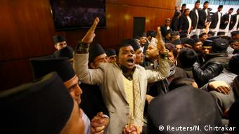 Constitution assembly members shout slogans during the meeting at the parliament on the final day to draft the new constitution in Kathmandu January 22, 2015 (Photo: REUTERS/Navesh Chitrakar)