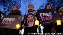 Raif Badawi protest. Protesters during an Amnesty International candle-lit protest vigil for blogger and free speech activist Raif Badawi outside the Saudi Arabia Embassy. In Mayfair, London. Picture date: Thursday January 22, 2015. See PA story PROTEST Blogger. Photo credit should read: Anthony Devlin/PA Wire URN:22020383