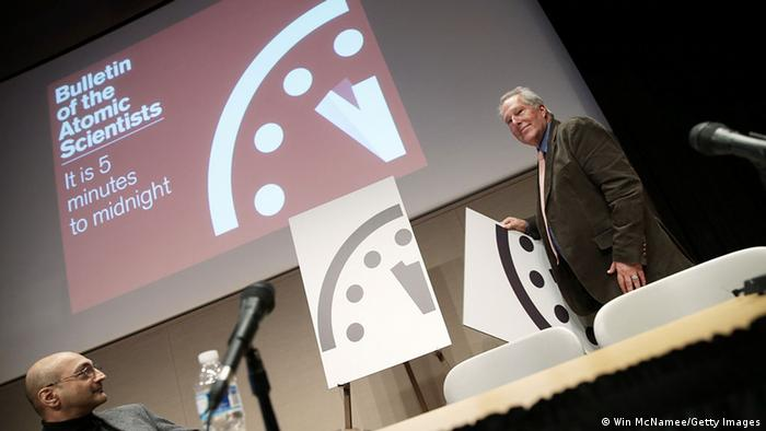Richard Somerville (R), research professor at Scripps Institution of Oceanography, unveils an updated version of the �Doomsday Clock� during a press conference held by the Bulletin of the Atomic Scientists January 22, 2015 in Washington, DC (Photo: Win McNamee/Getty Images)