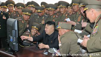 North Korean leader Kim Jong-un (C) looking at a computer screen along with soldiers of a long-range artillery unit at an undisclosed location in North Korea (Photo: EPA/KCNA SOUTH KOREA OUT HANDOUT EDITORIAL USE ONLY/NO SALES)